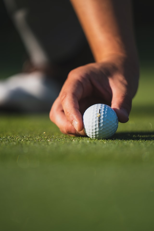 Golfball lined up on green